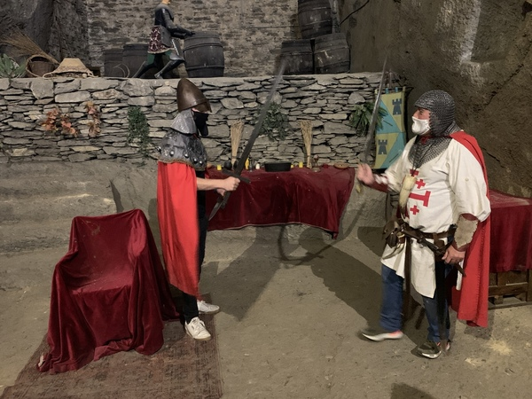 two men in medieval costumes jousting