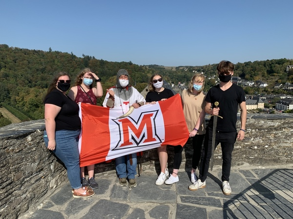 Students with a flag at Bouillon Castle