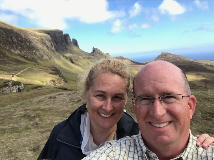 Man and woman with mountains in the background