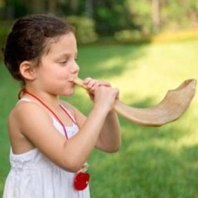 Child blowing a shofar