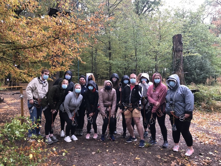 Students with masks in the woods