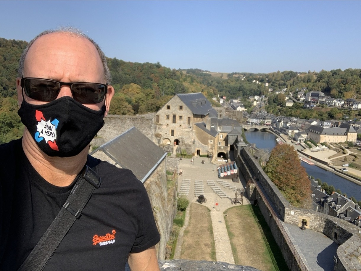 Man with mask with castle ground in the background