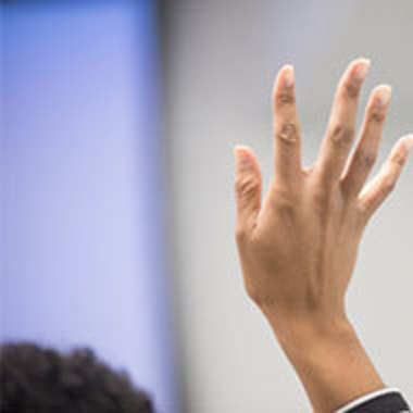 Woman's hand raised