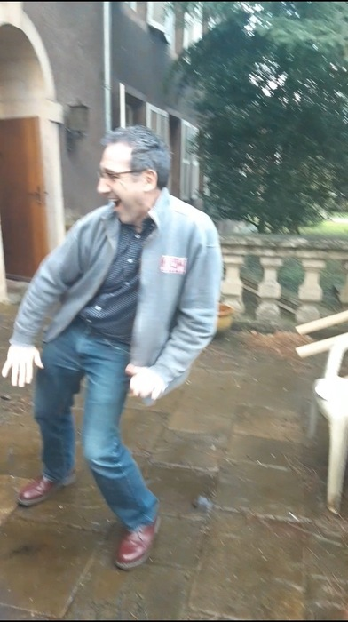 Dean Leterre dancing on the back patio