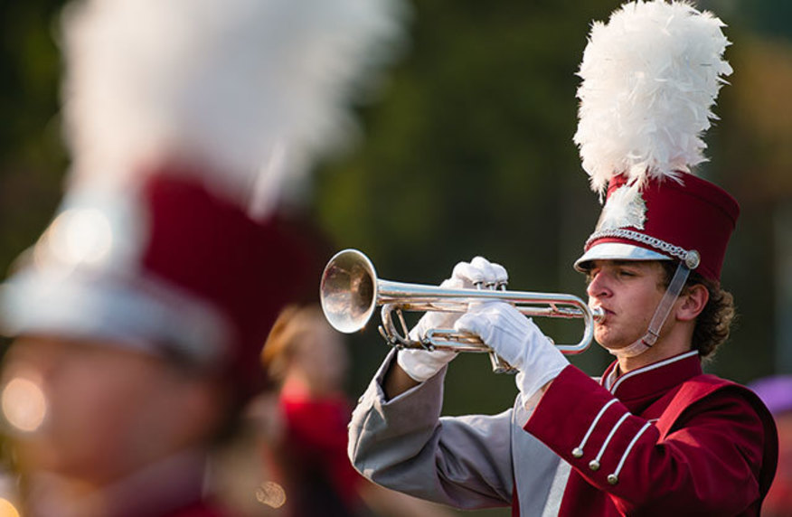 A trumpeter in the IUP marching band performed in uniform