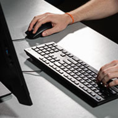 Person typing at keyboard
