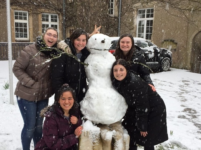 Catehrine Wegman and friends with a snowman at the Chateau
