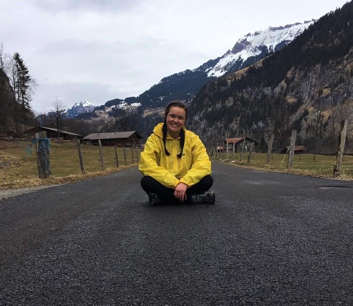 Sarah Kingsbury sitting on a road