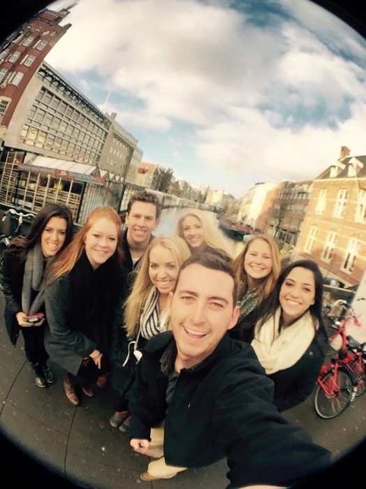 Ryan Bennett and friends on a canal in Amsterdam