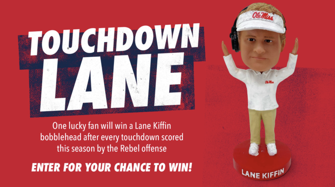 Graphic with a photo of the Lane Kiffin bobblehead and text that reads: Touchdown Lane One lucky fan will win a Lane Kiffin bobblehead after every touchdown scored this season by the Rebel offense ENTER FOR YOUR CHANCE TO WIN!