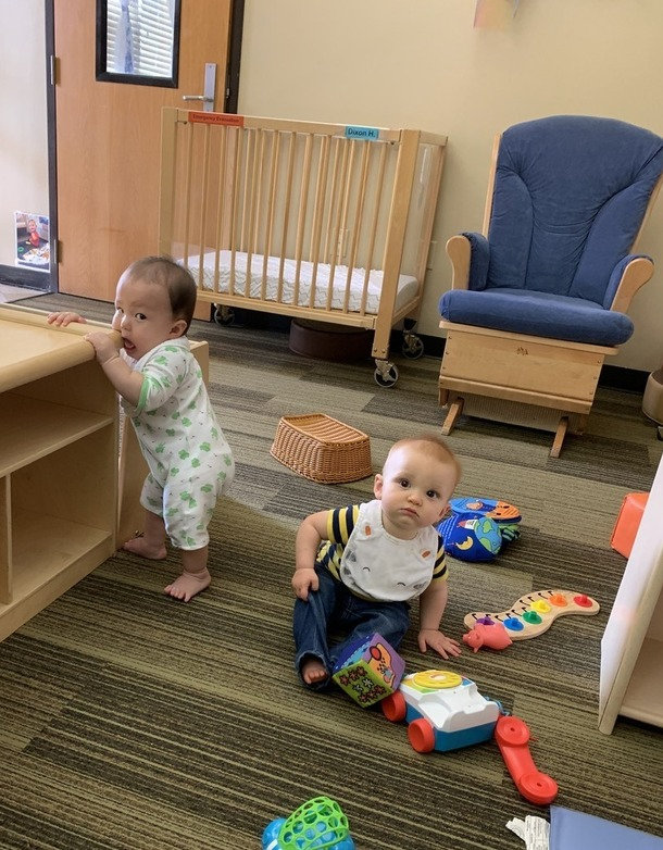 Two infants interacting with blocks