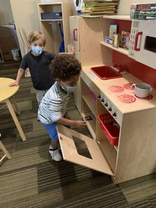 Preschool boys interacting with crafts