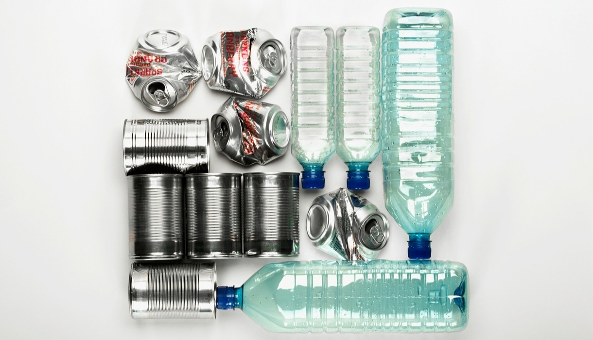 Photo of recyclables, including plastic water bottles and pop cans.