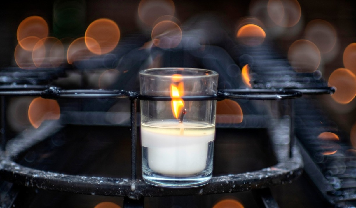 Photo of candle at the Grotto.