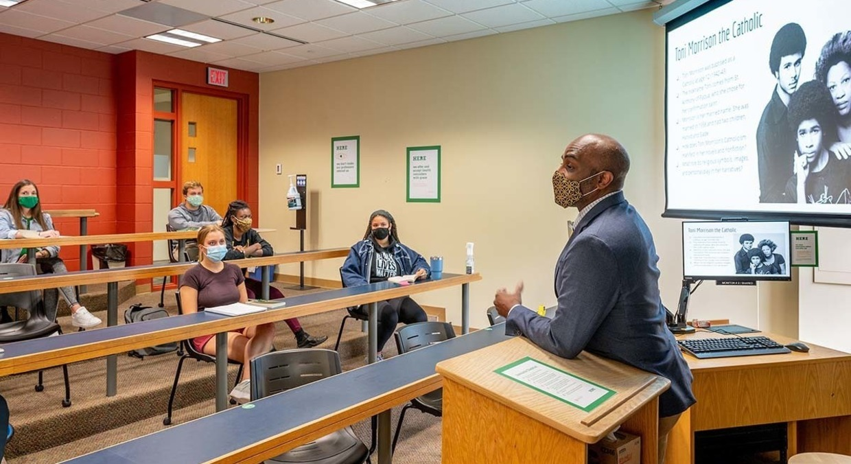 Photo of Ernest Morrell, professor of Africana studies and English, the Coyle Professor in Literacy Education and director of the Center for Literacy Education with students in the classroom.