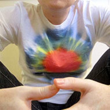 Closeup of male with tie-dye T-shirt