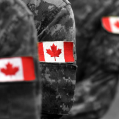 Black and white image of military uniforms with patches of the Canadian flag