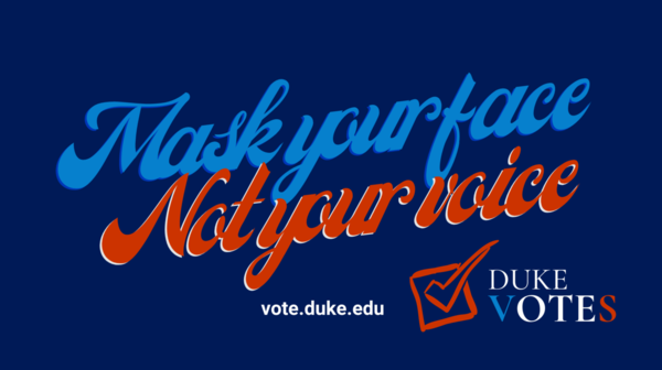 Duke Votes sign that says mask your face not your voice in blue and red