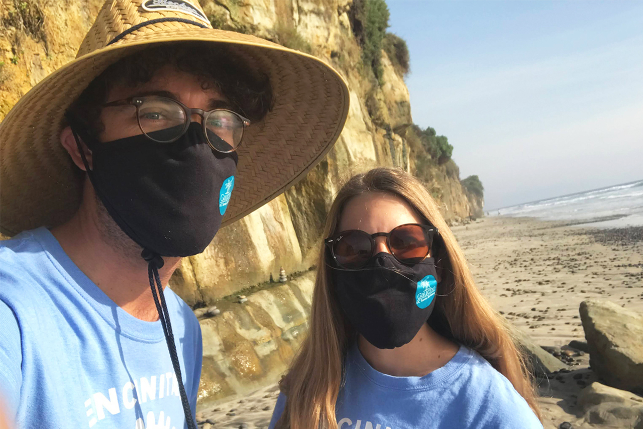 Alumni participating in a beach clean-up on Day of Service