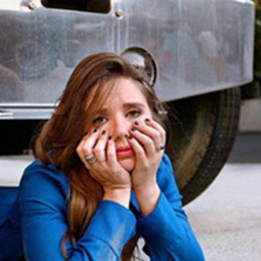 Natalie Palamides '12 under a truck