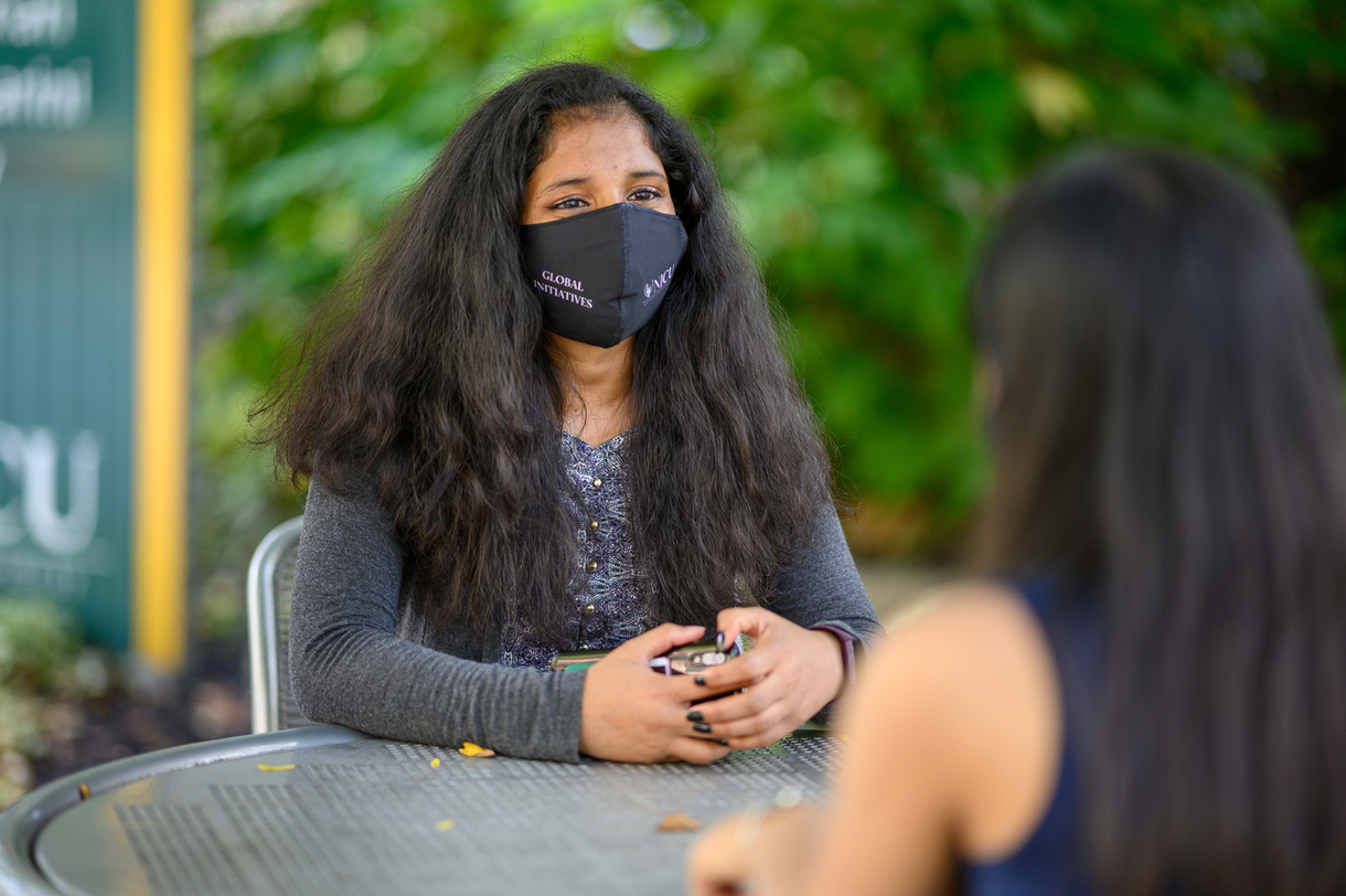Indian Students in the Global Initiatives Program wearing masks while gathered on campus