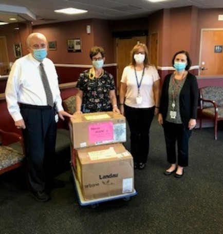 Pictured from left to right: Frank Azzarelli, executive director of EHC; Kathy Bunce, owner of Buffalo Scrubs; Karleene Epolito nursing supervisor at EHC and Barbara Johnson, director of Clinical Services at EHC.