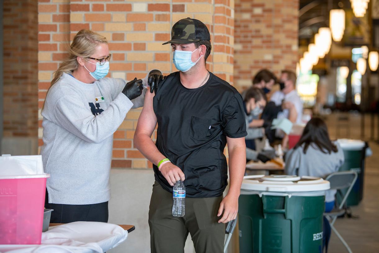 Photo of a graduate student receiving a flu shot.