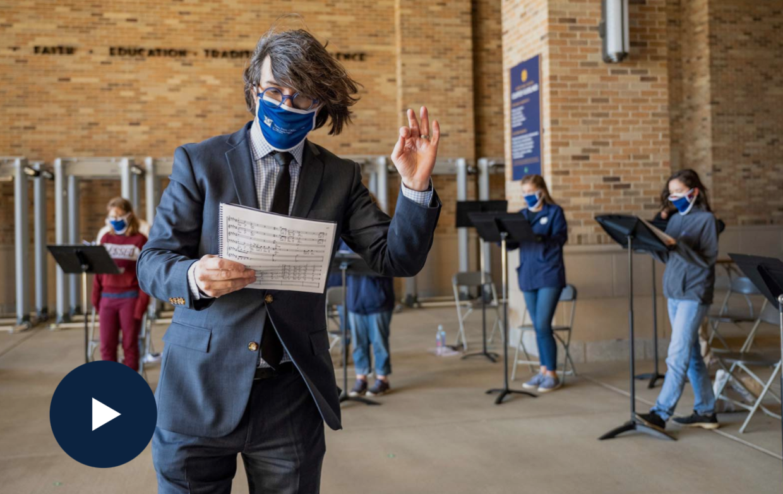 Photo of graduate choral conducting program practicing in Notre Dame Stadium