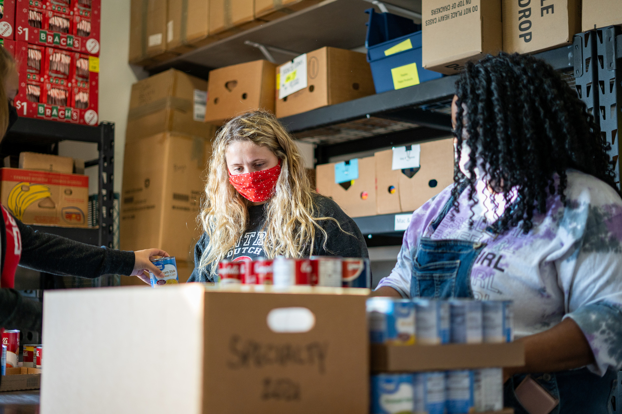 Masked female Central College students participating in the college's annual Service Day