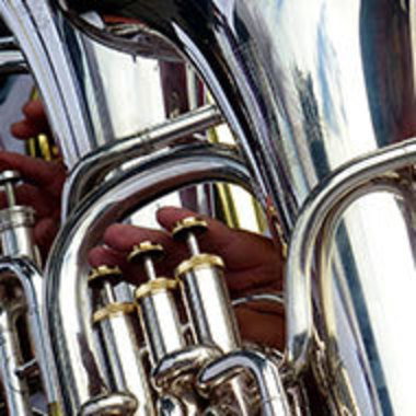 Close-up of tubas being played