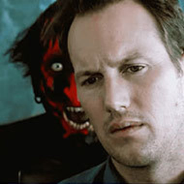 Movie image of character with demon behind him