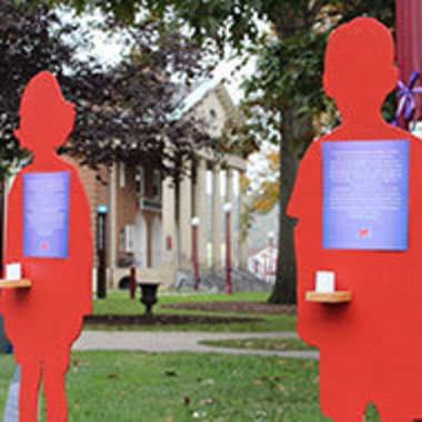Standing cutouts with stories affixed