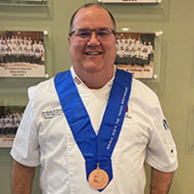 Andrew Nutter wearing his medal
