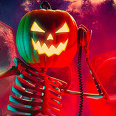 DJ skeleton with jack-o-lantern head