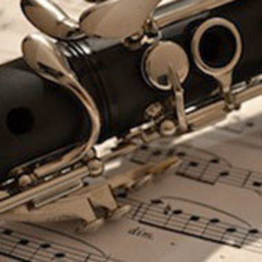 Detail of clarinet resting on sheet of music