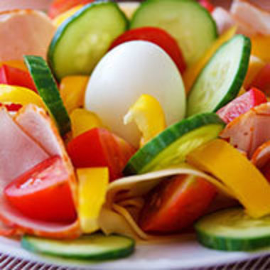 Salad with an egg in the middle