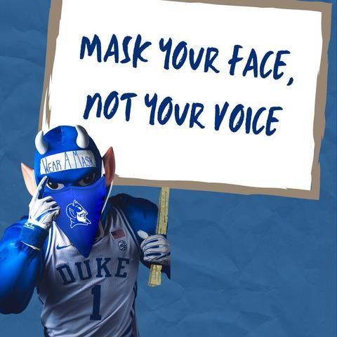 Blue Devil holding a sign that says