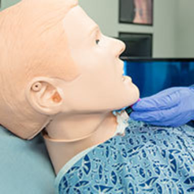 Closeup of person working with speech mannequin