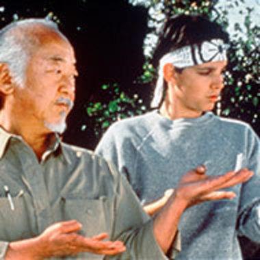 Movie scene with Mr. Miyagi training Daniel