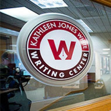 Closeup of Writing Center logo in window