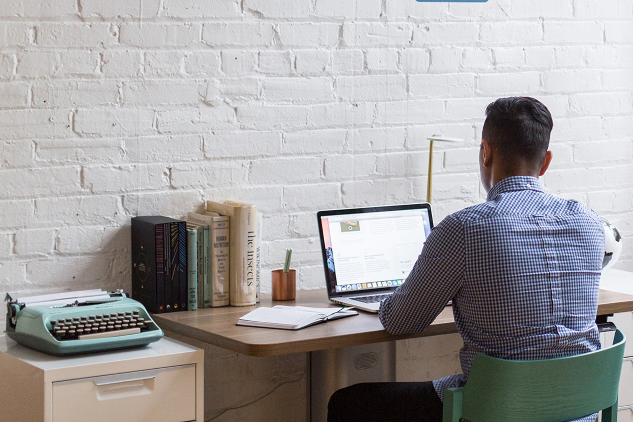 Man at desk with laptop