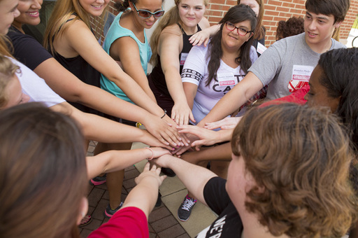 Students joining hands