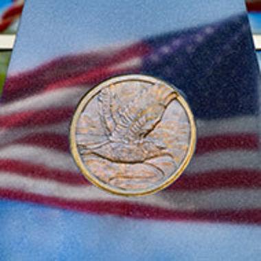 Closeup of IUP veterans memorial, reflecting the American flag