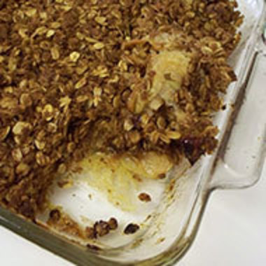 Partially eaten pan of apple crisp