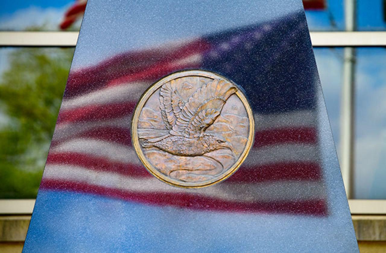 Closeup of IUP veterans memorial reflecting American flag