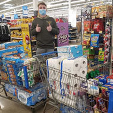 Robert Kanick grocery shopping with loaded carts