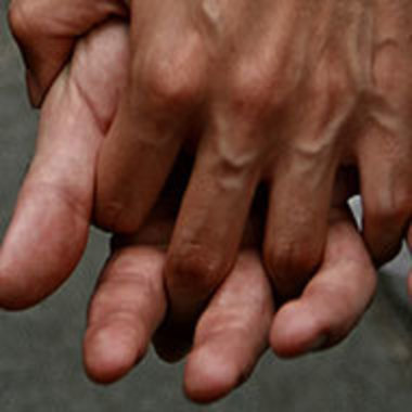 Closeup of hands of people holding hands