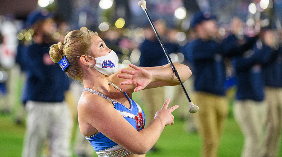 Baton being tossed by individual during half time show