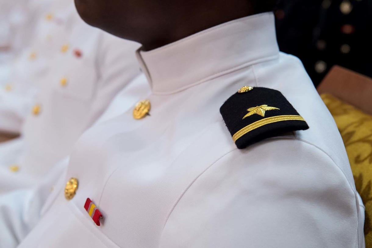 Photo of a young man in a naval uniform.