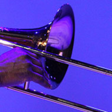 closeup of person playing trombone